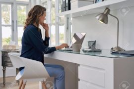 49226045-businesswoman-entrepreneur-working-on-laptop-from-home-office-space